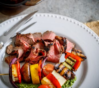 Peppercorn Butterflied Harvey Beef with Honey Cashew Pesto, Haloumi & Vegetable Kebabs