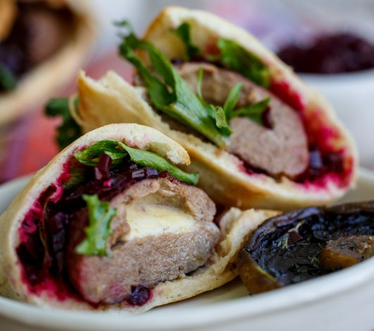 Harvey Beef burgers stuffed with melting mozzarella in pita breads with beetroot relish & roasted field mushrooms