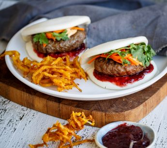 Grilled Harvey Beef burgers in bao buns, with crispy battered onions,