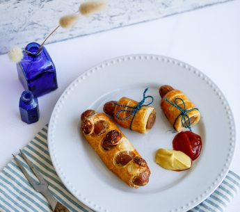 Sausages baked in puff pastry with mustard & parmesan