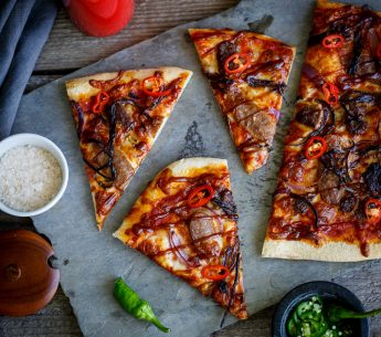 Harvey Beef meat lover's pizza with beef sausages, beef burgers, caramelized onion, cheese & tomato