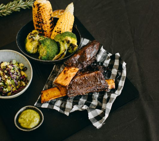 Texas Ribs slow cooked w/ smoky BBQ Glaze, Charred Broccoli slaw & green goddess dressing