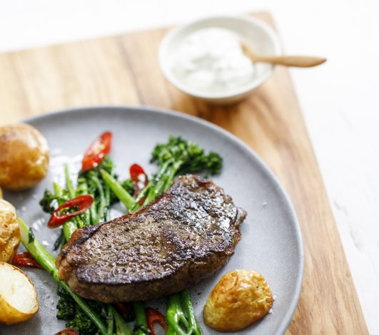 Porterhouse Steak with Roasted Baby Potatoes, Sautéed Broccolini & Chilli, Herbed Sour Cream